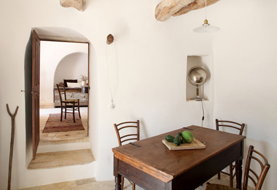 Vernacular architecture in the Trullo style, photographed by Claudio Santini. Interior and furnishings selected by the owner, Emanuele Amoroso.