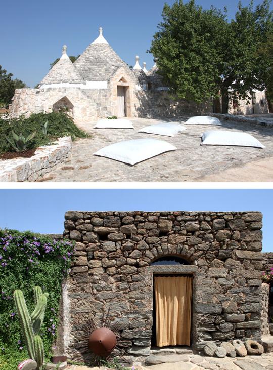 Two examples of vernacular architecture photographed by Claudio Santini. Both examples show the Trullo style typical of Puglia, Italy. House shown on top was remodeled by architect Silvia Prevedello.