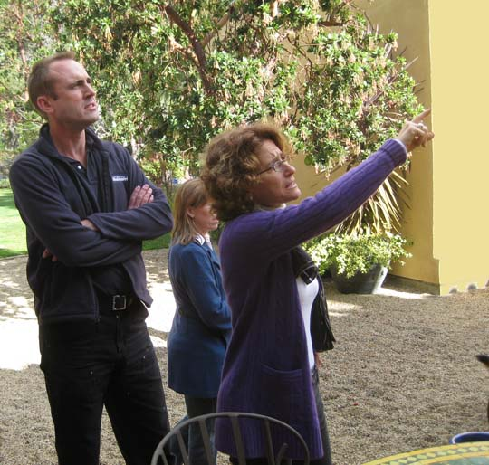 Karin Payson, right, directing work at one of her projects.