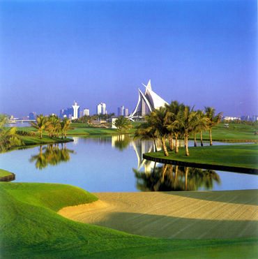A golf course sits like an emerald jewel in the middle of the desert in Dubai.