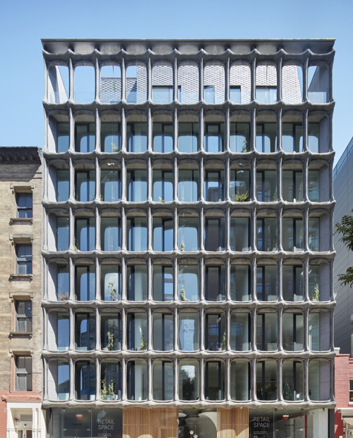 The XOCO 325 condominium building at 325 Broadway in NYC, shown in context. The granite-gray colors help to knit this building's surrealist Gaudi-like sensibilities together with the surrounding buildings, also recalling the types of granite and slate found in New York State. By DDG.