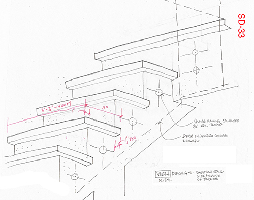 Detail of stair from basement to first floor, showing placement of attachment bolts for the glass panels along the side of the stair. Image: Mark English Architects