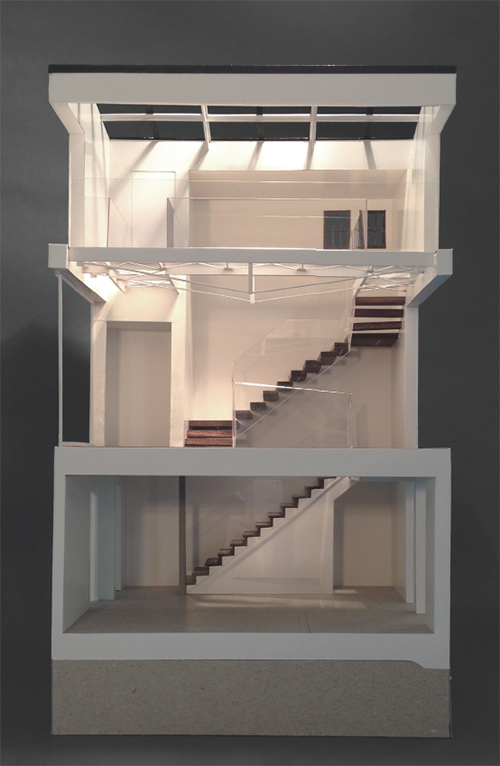 A physical model shows the stair's progression through the house, from basement to upper story. Image: Mark English Architects